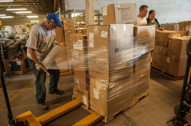 Boxes of needed supplies and equipment are palletized before shipment to Hungary.