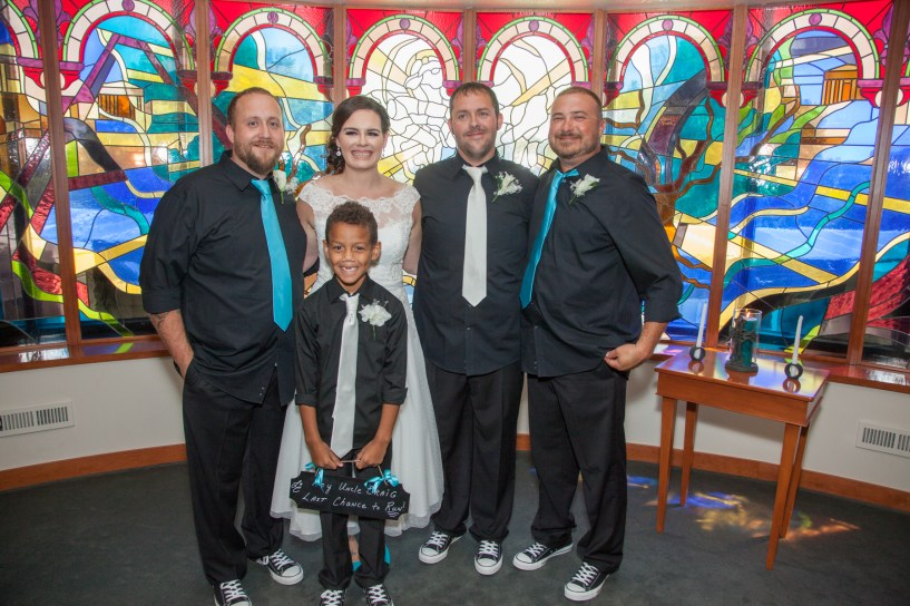 Bride and groom join groomsmen and ring bearer