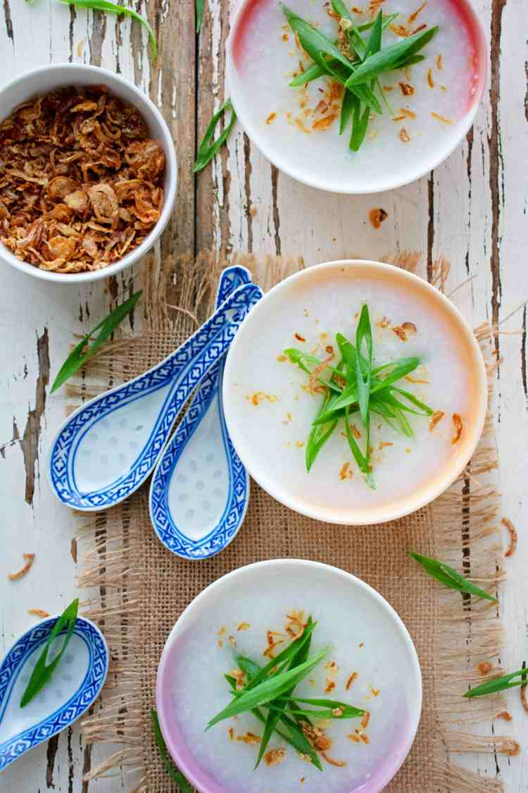 Top down view of 3 bowls of congee.
