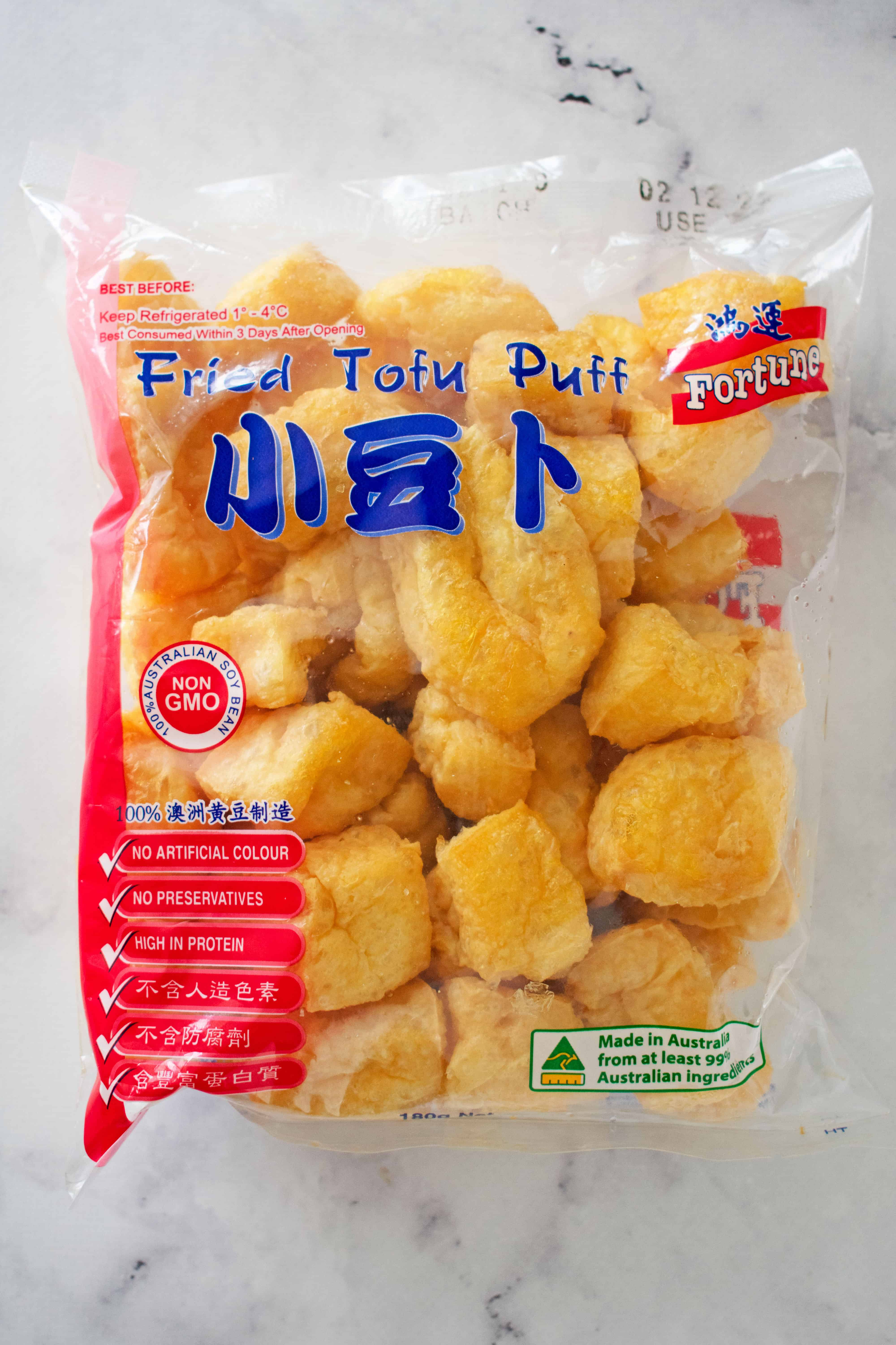 A clear packet of fried tofu puffs.
