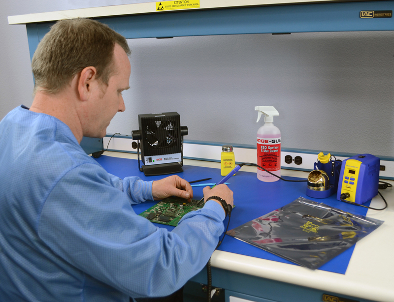 Employee working at an ESD Protected Workstation