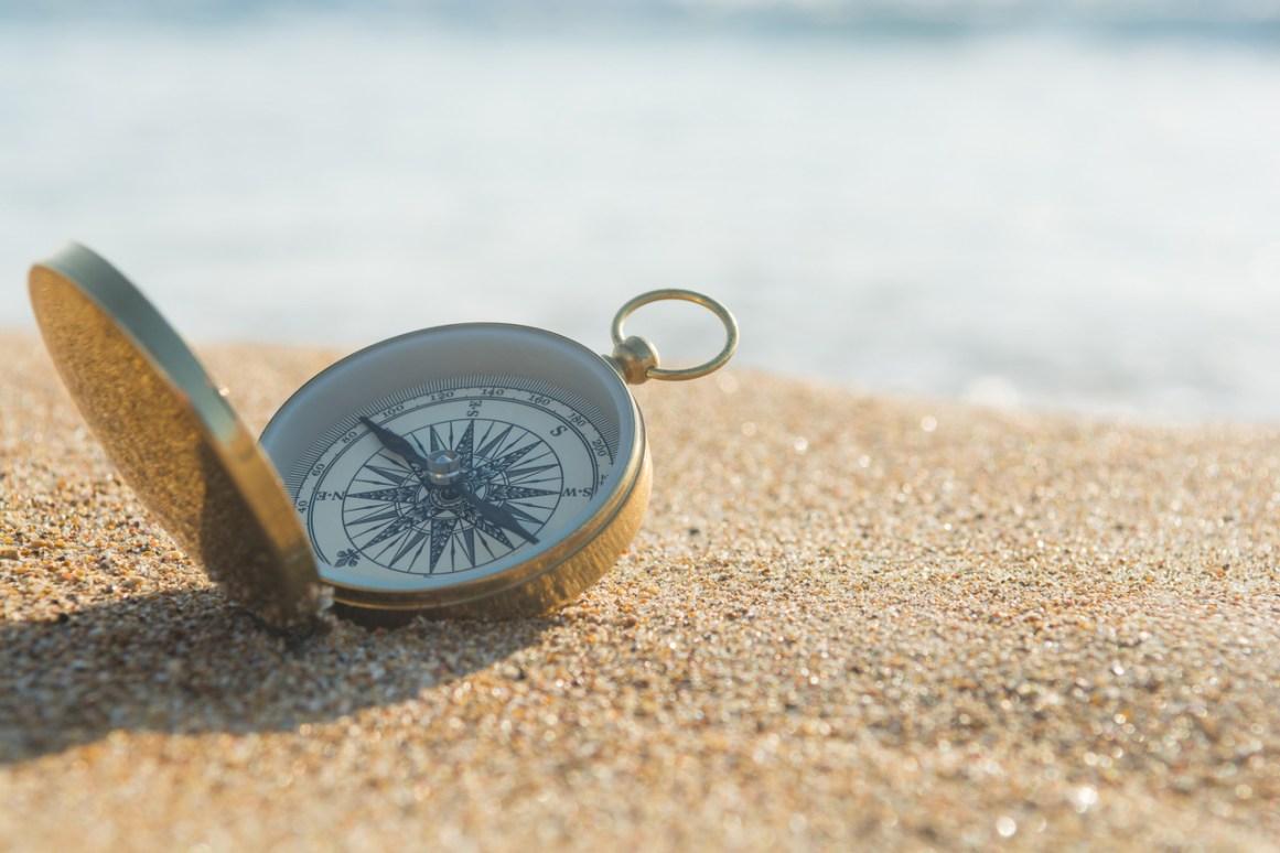 compass on beach
