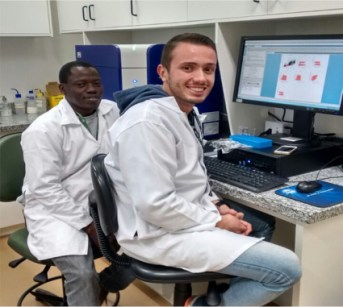 Adekunle with a PhD colleague, Amauri da Silva Justo Junior. during a flow cytometry session in the Cellular and Molecular Laboratory, UNICAMP.