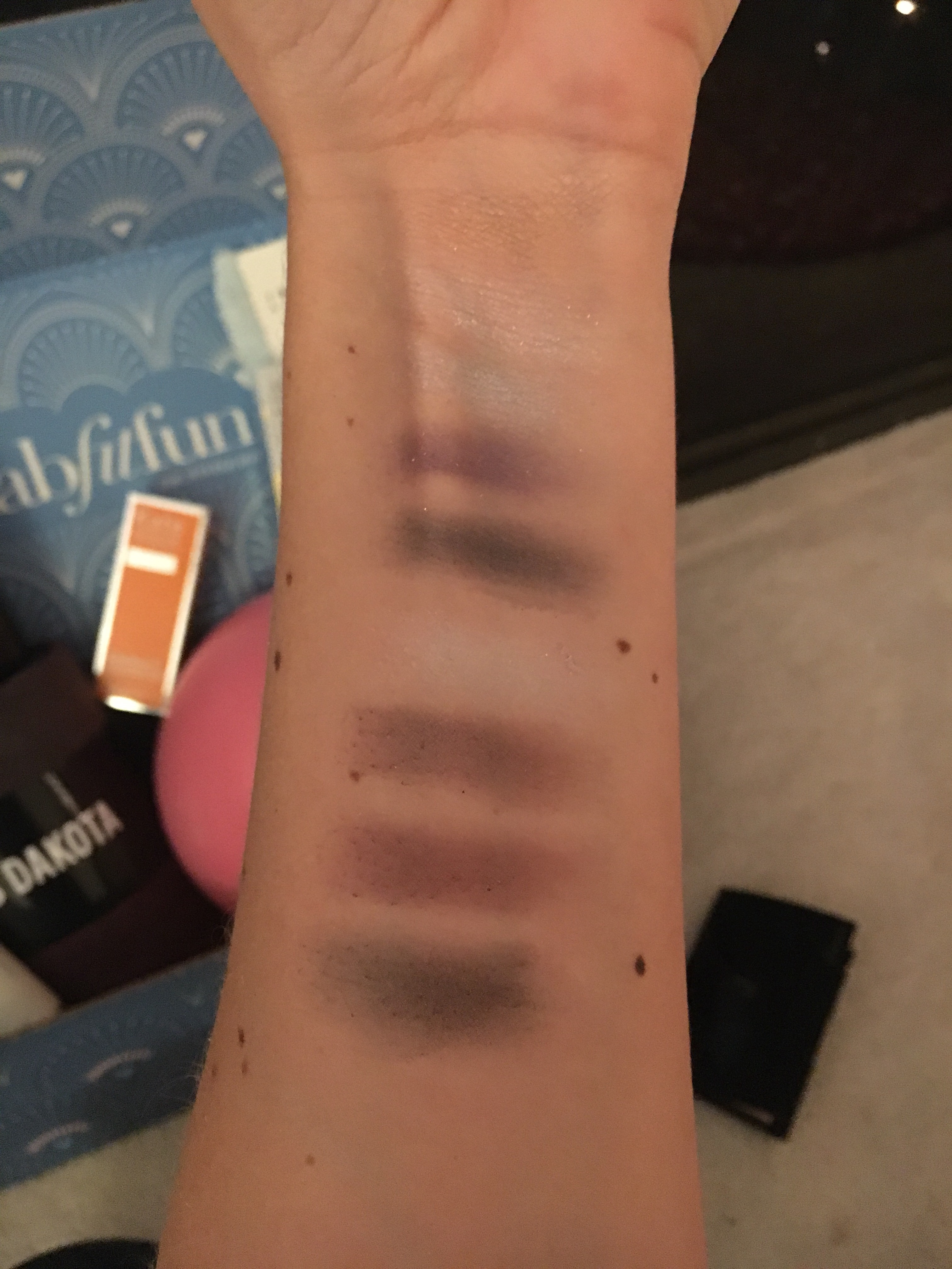 Here are color swatches for the Doucce palette. The top color on my arm is the shimmery highlight pan. The eight eyeshadows are underneath.