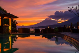 Sunset over the pool at Lembeh Resort offers a stunning view of Lembeh Strait.