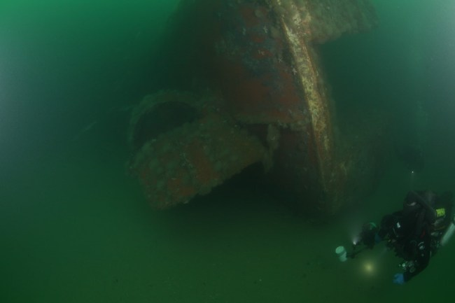 Patriot lies partially-buried in the sandy seafloor of Stellwagen Bank National Marine Sanctuary.