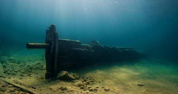 The lower hull of Fay sits in shallow water not far from shore in Thunder Bay National Marine Sanctuary. (Photo credit: David J. Ruck/NOAA)