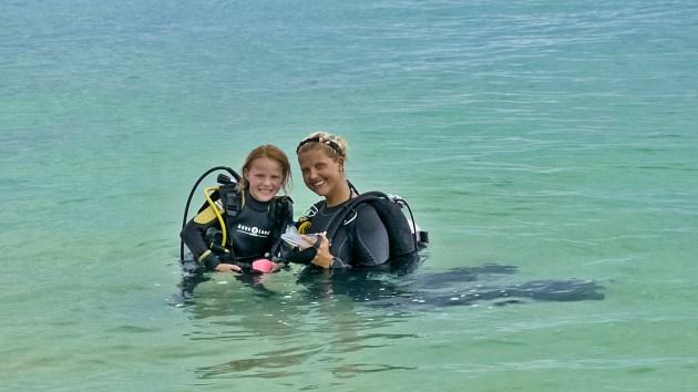 Vieve Bettle on a dive with a Wakatobi divemaster (Courtesy Wakatobi Resort)