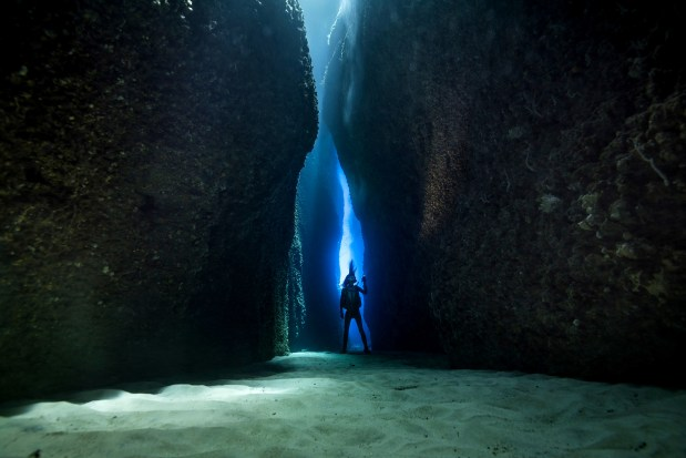 Diving at Leru Cut is an otherworldly experience, with light streaming from above and crystal-clear water. (Photo credit: Matt Smith)