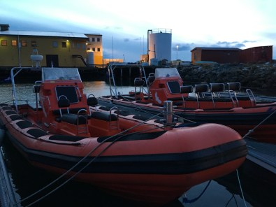 Two of Lofoten Opplevelser's orca-hunting boats await on our first morning out on the water. (Photo by Rebecca Strauss)
