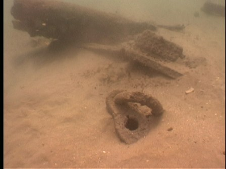 Wreckage in the sand, including part of an anchor (Photo courtesy Florida Division of Historical Resources).