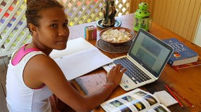 Lorie studying reef fish ID at Magnetic Island, Papua New Guinea