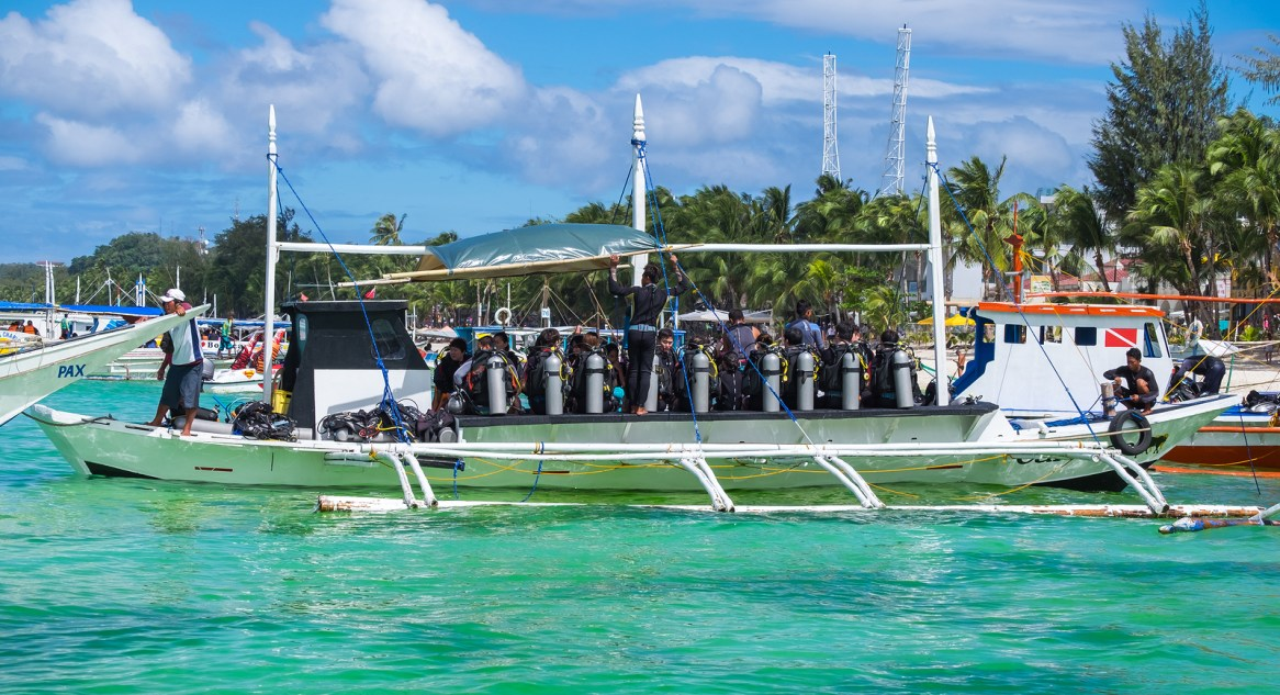Boracay, Philippines - February 25, 2016: Divers at diving boat