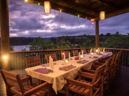Dinner is served with a spectacular view on an open-air deck overlooking Tufi fjord. (Image courtesy of Tufi Dive Resort)