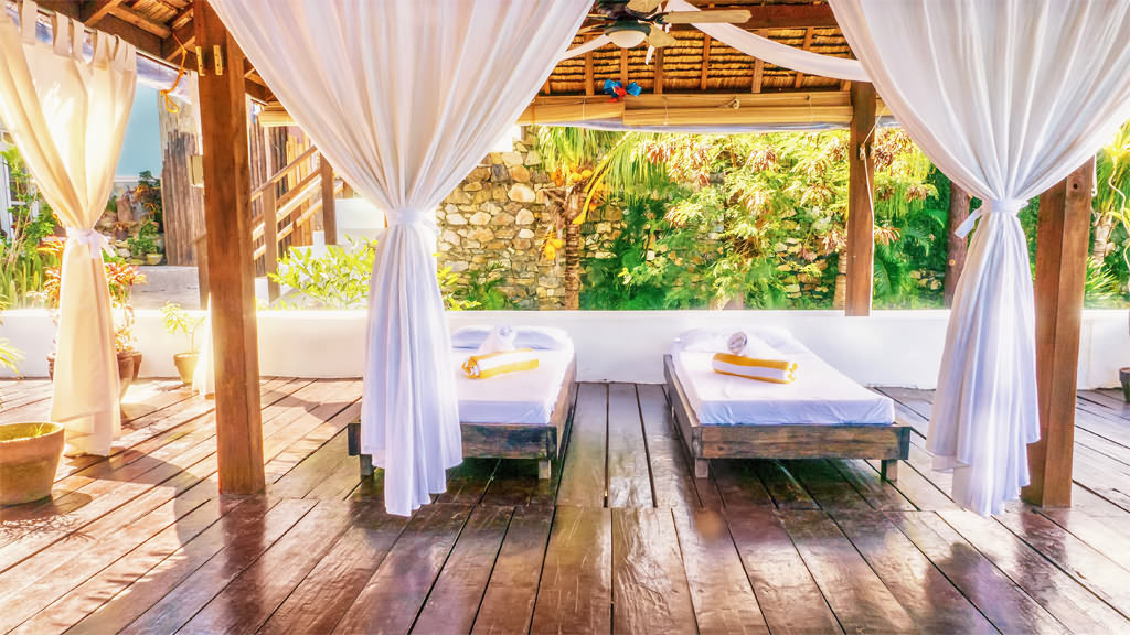 Spa services offered next to the garden or in your suite. (Courtesy Edgewater Dive and Spa Resort)
