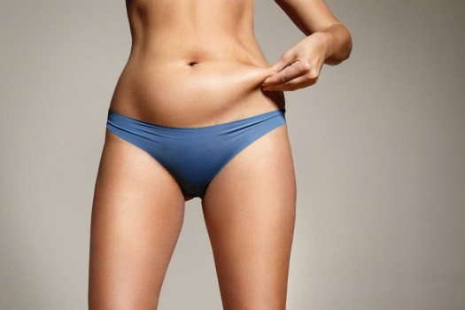 Woman Pinched Her Fat On Body