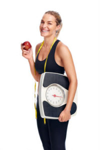 Woman with Weighing Scale