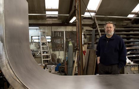 Compere with sculpture in his studio in Florenville, Belgium