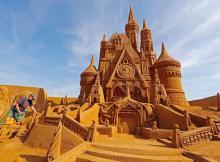 Sand Sculpture of Disney Castle by carver Susanne Paucker
