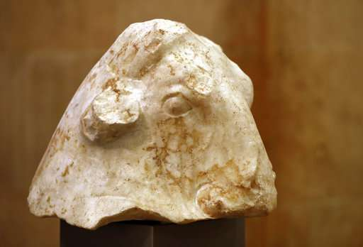 ancient sculpture on display of bull's head in Lebanon