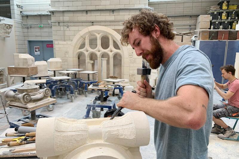Apprentice stone carver Francois Menut at work