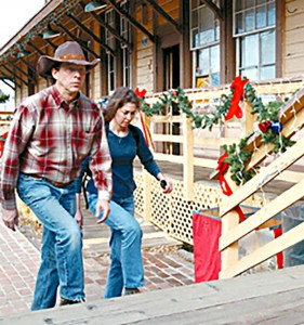 Phil Scorza,of Castaic and Alice Pilkey, of Saugus walk up the steps toward the entrance of the Saugus Train Station in Newhall of which is lined with Christmas decorations for the Santa Clarita Valley Historical Society's Christmas Open House.