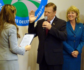 City Clerk Sarah Gorman adminsters the oath of office to Councilman Bob Kellar as his wife, Kathy, watches.