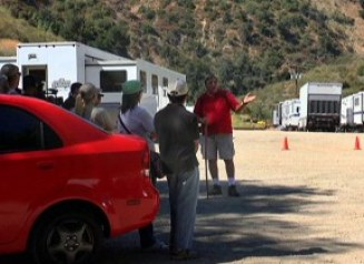 "7/24/2011: The writer gives a tour against a backdrop of honey wagons and production trucks for the film currently titled ""Mentryville."""