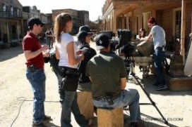 """Director-Editor Kirk Murray (red shirt) preps a scene for """"Six-Gun Savior"""" on Main Street, Melody Ranch. The indie film is due out in 2014."""
