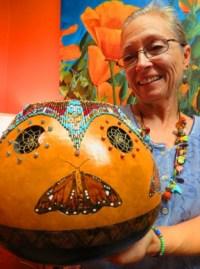 Local artist Nadiya Littlewarrior displays one of her pieces.