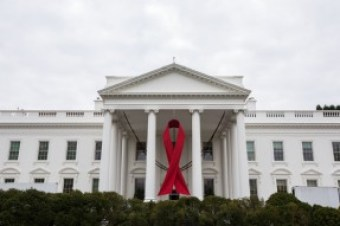 A red ribbon hangs from the North Portico of the White House on Dec. 2, 2013 to mark World AIDS Day, Dec. 2, 2013 (Official White House Photo by Chuck Kennedy)