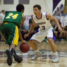 Valenia High School's Issac Davis (3) defends against Canyon High School's Derek Range (22) Tuesday Jan. 21, 2014. Valencia's defence was to much to handle for Canyon as they lost to Valencia 81-49.