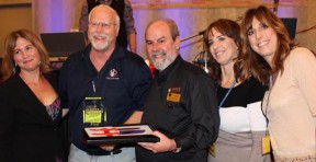 From left: Tracey Gold presents the first place Chili Cook-Off trophy to Ray Tippett and Patrick Raach with Marcy James and Nicole Stinson.