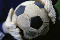 soccer ball in goalie's hands