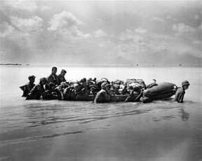 Marines wounded during the landing on Tarawa in November 1943 are towed out on rubber boats to larger vessels that will take them to base hospitals. Photo: USMC