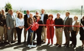 Connie Worden-Roberts (in red - always in red) at a ribbon cutting for the cross-valley connector in 2010.