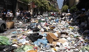 Rubbish is seen in the street during a protest in downtown Naples