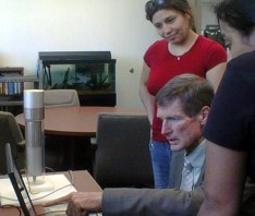 CSUN College of Science and Math Dean Jerry Stinner observing two students measuring uranium levels in his office. Photo: CSUN