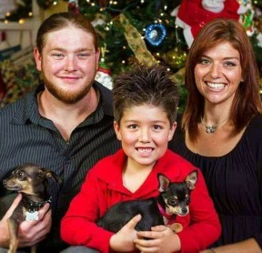 Jenifer, Jeremy, Caleb and the family's two dogs. The dogs perished in the fire.