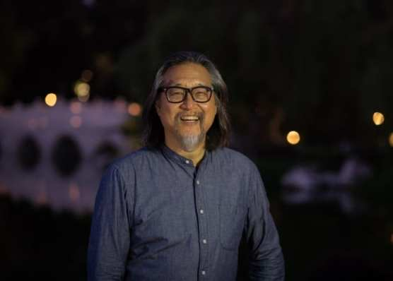 "Playwright Stan Lai in the Chinese Garden at The Huntington, the inspiration for his play ""Nightwalk in the Chinese Garden."" 
