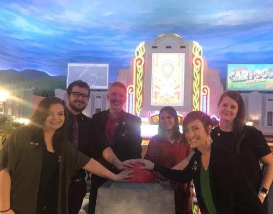 CalArts School of Theater alums Rob Bisser (MFA 08), Hope Glomski (MFA 11), Kat Reinbold (MFA 12), Amber Lepley (MFA 15), Jesse Fryery (MFA 17) and Alyssa Damminger (BFA 18) at the world opening of Warner Bros. World Abu Dhabi. | Photo courtesy of CalArts Alumnx Office.