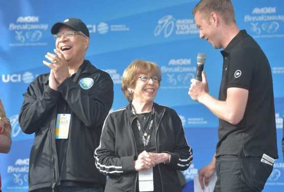 Brad Sohner, right, interviews City of Santa Clarita Councilmember Bill Miranda, left, and Mayor Marsha McLean before the start of the AMGEN Tour of California races in Valencia on Saturday. | Photo: Dan Watson/The Signal.