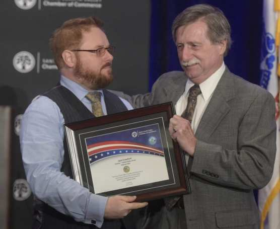 Vietnam veteran Jack Crawford, right, receives the plaque from his son Jason Crawford during the 9th Annual Patriots Luncheon presented by The Santa Clarita Valley Chamber of Commerce and the City of Santa Clarita at the Hyatt Regency Valencia on Thursday.   Photo: Dan Watson/The Signal.