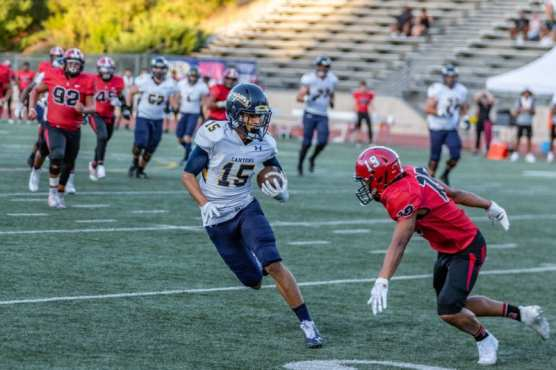 College of the Canyons freshman receiver Trey Longstreth runs with the ball in a matchup with Santa Barbara Sunday night. | Photo: Cory Rubin/The Signal.