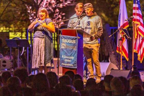 Riley and Brady Muehlberger give a tearful speech about their sister, Gracie Anne Muehlberger at the Saugus Strong Vigil Sunday night.   Photo: Cory Rubin / The Signal.