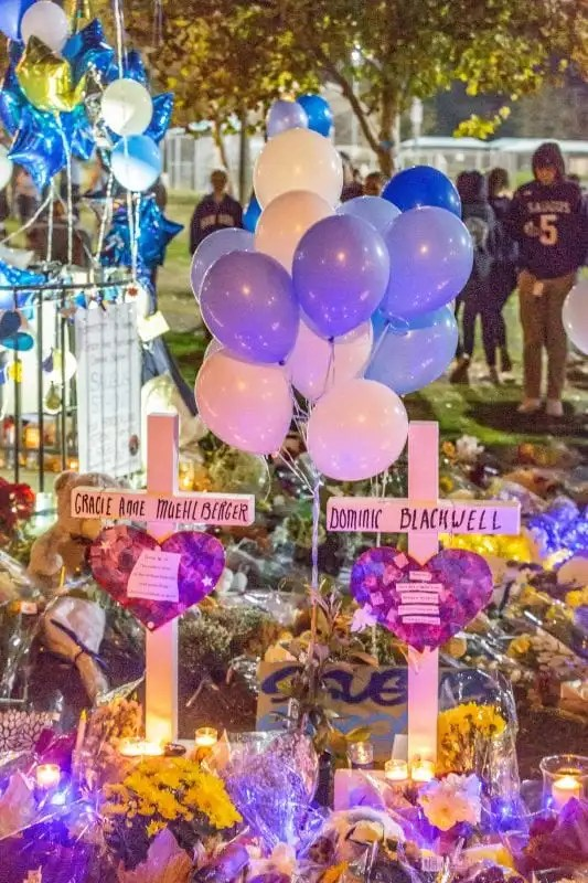 strong - Two crosses sit at the memorial set up at the Central Park flag pole at the Saugus Strong Vigil Sunday night. | Photo: Cory Rubin / The Signal.