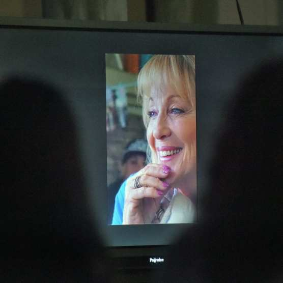 Attendees watch a video created by the family of Heidi Levy presented during her memorial held at Bowman High School on Thursday, December 19, 2019.   Photo: Dan Watson / The Signal.