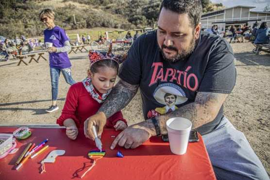 Janis Bravo, left, and her father Edgar, right, work on crafting activities at an opening event for Straightening Reins ranch Saturday afternoon, December 14, 2019. | Photo: Bobby Block / The Signal.