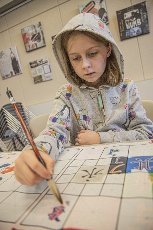 Alex Anderson, age 9, paints newly learned Chinese characters at the SCV Chinese School's Chinese New Year Celebration at the Newhall Library on Saturday, January 18, 2020.   Photo: Bobby Block / The Signal.