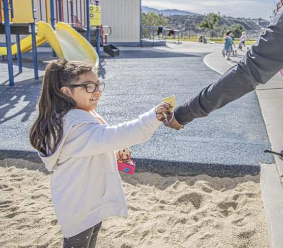 """Highlands Elementary student Ashley Lazcano takes a kindness slip as part of the school's """"Great Kindness Challenge"""" on January 30, 2020. 